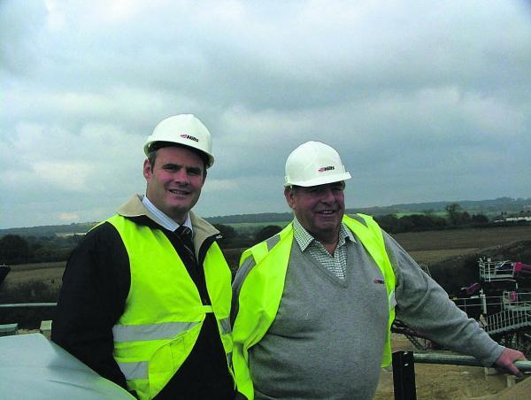 Robert Hill, one of the leading lights of the Hills Group, with his son Michael, who is now the firm's chief exectutive