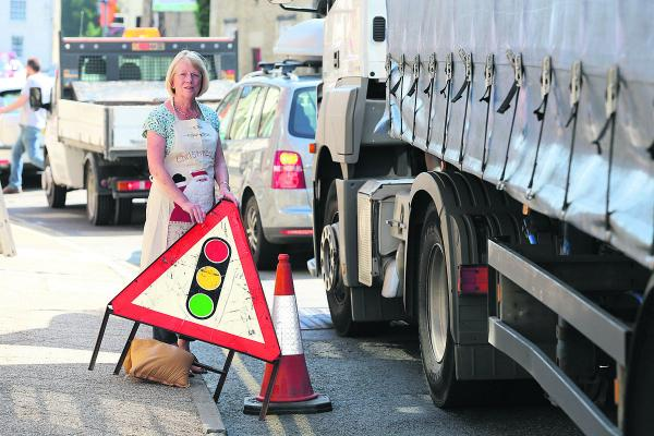 Judy Hurt, the owner of the Christmas shop in Lechlade, is angry about the traffic problems in the town due to the roadworks on the A420 Swindon to Oxford Road