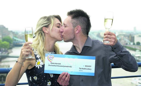 Robin Marriott and girlfriend Keana Marsh celebrate his big £100,000 Health Lottery win