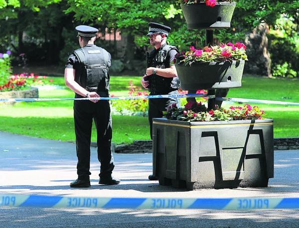 Police cordon off the area where the stabbing occurred in Town Gardens