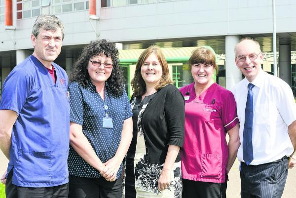 Members of the breast cancer team are, left to right, Dr Nick Ridley, director of  radiology, receptionist Pam Durston, breast cancer manager Suzie Ferrari, imaging assistant Anne Fullerton, and consultant breast surgeon Nathan Coombs