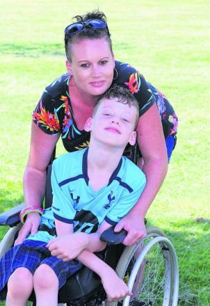 Eight-year-old Robbie Davies, who has cerebral palsy, pictured with his mum Kelly