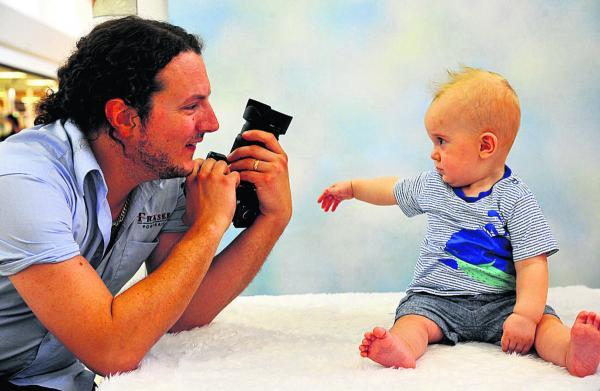 Swindon Advertiser Baby of the year entrant Jude  discusses camera angles with Ross Jennings  at the West Swindon Centre
