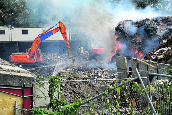 Recycling firm frustrated as blaze still burns