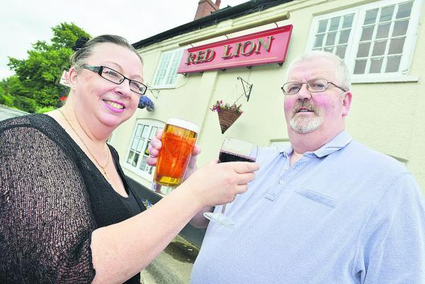 Cheers! Julie Wyatt and Mark Farrell  propose a toast to the future of the Red Lion