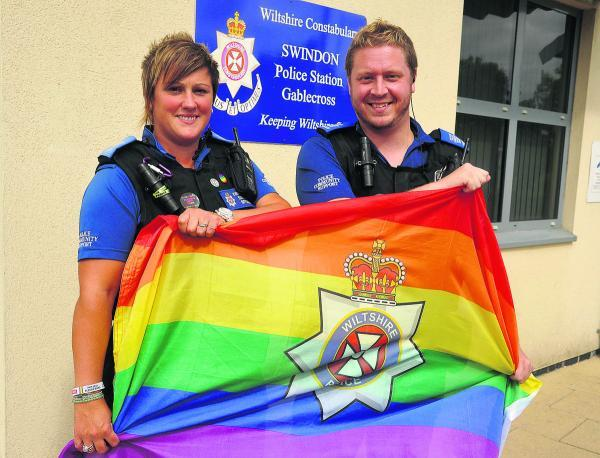 Kate Jason-Collier and Lee Hare with the rainbow flags which will be flown from Gablecross police station and Devizes HQ in support of the Pride event