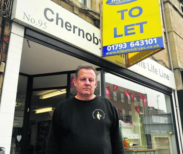 Volunteer David Simonds at the Chernobyl Charity Shop in Old Town,which is closing down