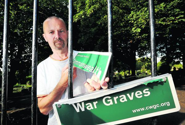 Mark Sutton, of the Swindon in the Great War group, is upset that the Commonwealth War Graves sign at Radnor Street Cemetery has been vandalised