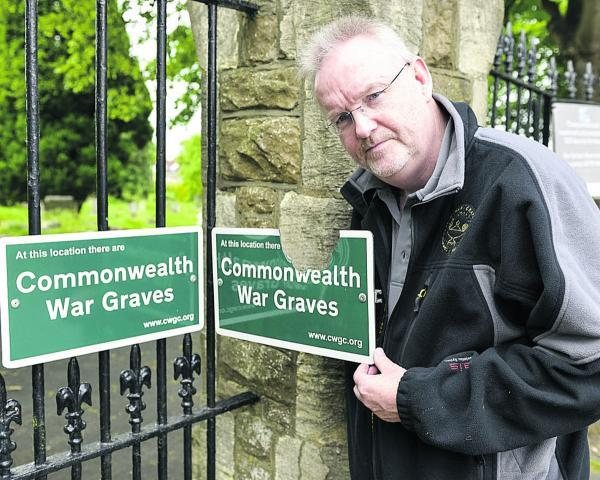 Andy Knowlson, Regional Supervisor West Region for the Commonwealth War Graves Commission, pictured after replacing a vandalised sign at Radnor Street Cemetery