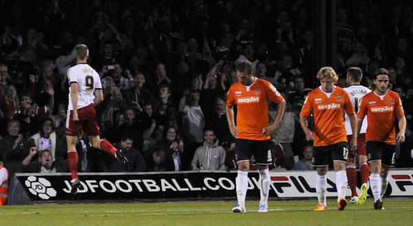 Michael Smith celebrates in front of the Town fans after his penalty against Luton