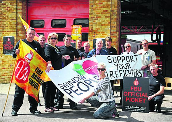 Kate Linnegar of Swindon People's Assembly, front, with picketing firefighters at Drove Road Fire Station yesterday