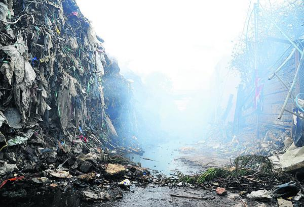 The smouldering piles of waste have been scooped up to assist in helping the Averies recycling fire burn itself out