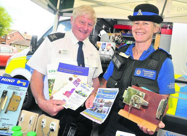 Rod Law and Juliet Evans of Wiltshire Police taking part in the crime prevention session at the shops in Beechcroft Road