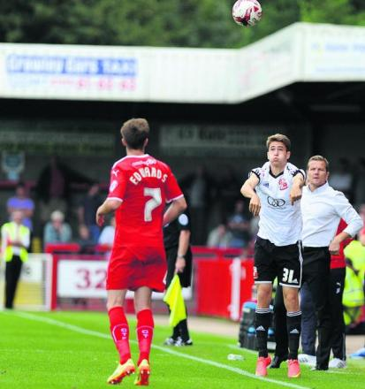Youth teamer Will Randall takes a throw-in, watched by Town boss Mark Cooper after coming on as a substitute at Crawley