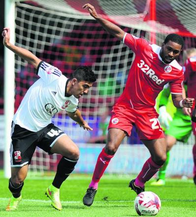 Town's Mass Luongo and Crawley's Gavin Tomlon strike a pose while battling for the ball