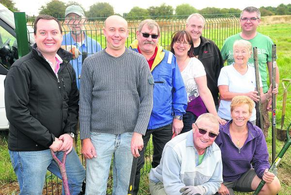 Residents and councillors prepare to set up fencing around the new Nythe Allotments