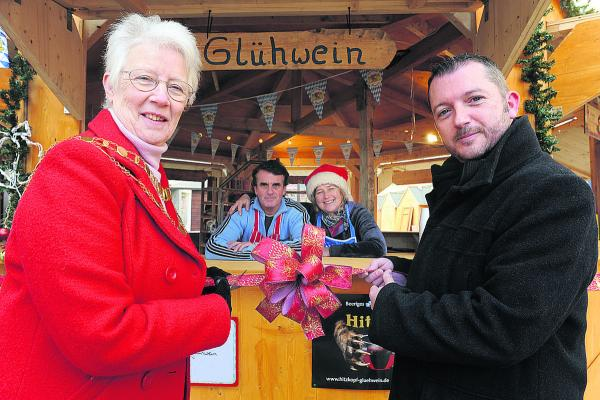 Former Mayor Ray Ballman, former CEO on inSwindon Simon Jackson and German stall owners Bruno Girardea and Sonia Luther-Schreiber at a previous Christmas market