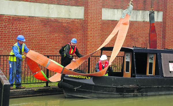 Canal trust's cruiser lifted from water