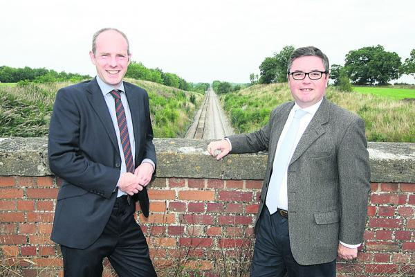 Swindon MPs Justin Tomlinson and Robert Buckland pictured at the redoubling work site