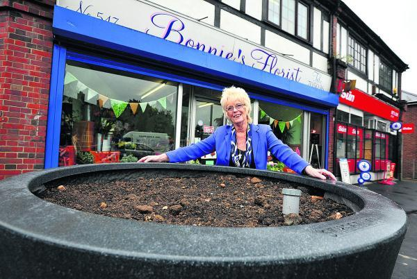 Bonnie Bull, the owner of Bonnie's Florist, in Pinehurst, is pleased with the new giant pots the council has placed outside the shop