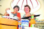 Sylvia Dowling and Clare Stow at work behind the counter at Options for Living cafe