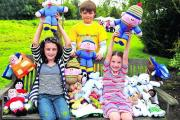 Having a great time with their knitted friends at a previous Prospect Hospice summer fete are, left to right, Millie Anderson, Oliver Shimell and Isabel Anderson