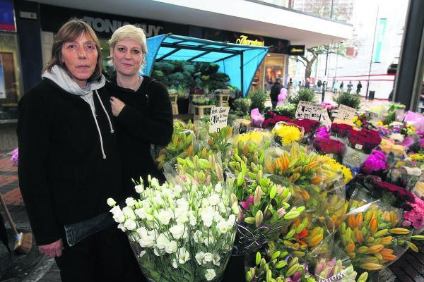 Beth Howes, left, and Jackie Clark at their flower stall in the town centre