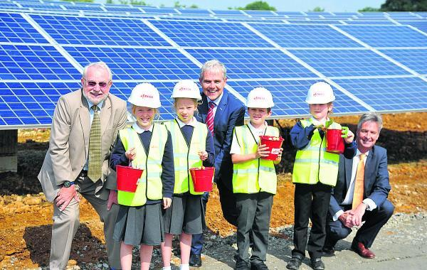 Children from South Marston School opening Sevor solar farmin  South Marston. From left,  Coun Barry Thunder,  Phoebe, Lily, Peter, Paul Weeda, a director of Eneco Solar, Toby, Jamie and  Guy Madgwick a director Eneco