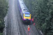 Engineers inspect track before the train near Corsham could move this morning. Picture by Trevor Porter