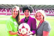 Sarah Wilsdon, centre, daughter of Kevin Morris, with Sian Griffiths, Swindon Town's  charity co-ordinator, right, and Hayley Tarrant, community fundraiser for the Samaritans, with a signed ball which will be raffled at the County Ground