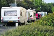 A convoy of travellers' caravans makes its way to Rivermead Industrial Estate
