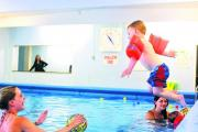 Kelly Halford and Tyler-Jay make a splash as part of a Children's society scheme to get kids swimming