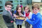 Year five pupils from Moredon Primary school pictured with their winning fruit pie. Left to right are Joseph Aldridge, Larna Luffman-Kemp, Abby Cantelow and Theo Lender-Swain