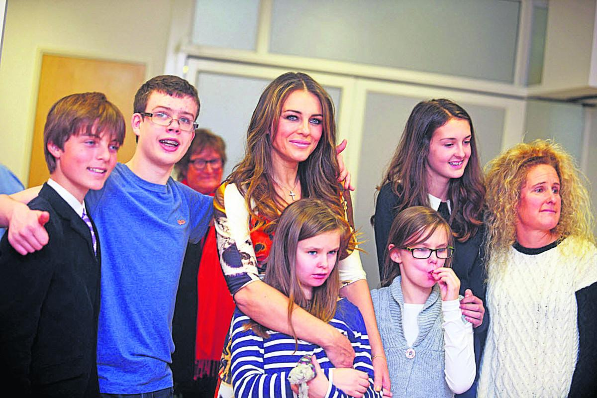 Actress Elizabeth Hurley, with her son, far left, launches the respite care facility for Hop, Skip And Jump