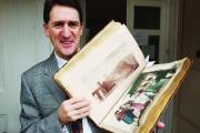 Smiling, as usual, the late Dominic Winter, well known to viewers of TV's Antiques Roadshow, displays another historic volume set to go under the hammer at his auction-house