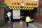 Lorry lodged under Corporation Street slows traffic. Picture by Beren Cross