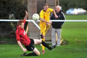 Action from Highworth's (red) Vase win over Bridport on Saturday