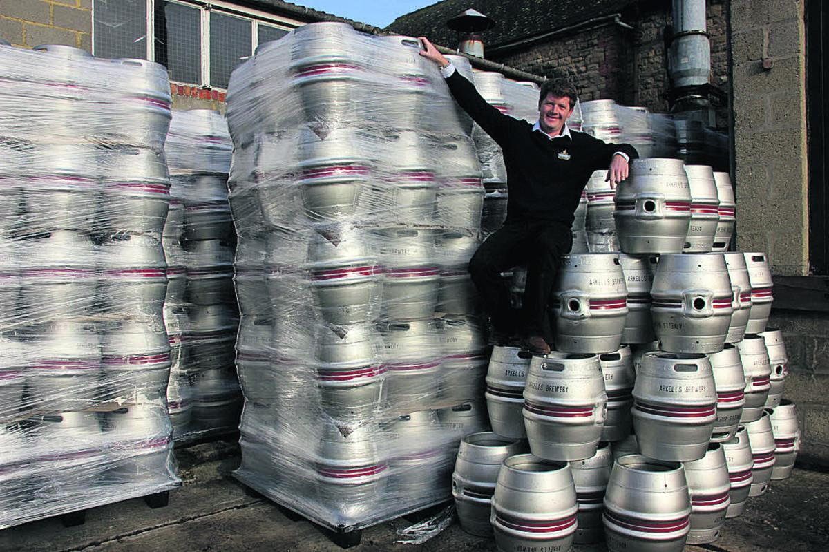 Arkell's head brewer Alex Arkell with the 500 stainless steel barrels which are to replace more of the aluminium casks that have been in regular use at the brewery since the 1960s
