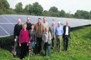 The directors of WWCE in front of the Chelworth solar farm. Chairman Lesley Bennett is pictured, front left