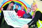 Pauline Edmondson dyed her hair all the colours of the rainbow to support the Chalet School, where she presented a £1,500 cheque. Pictured, left to right, are Kathie Bryan, headteacher, pupils Ryan, Matthew and Charlie, and fundraiser Pauline