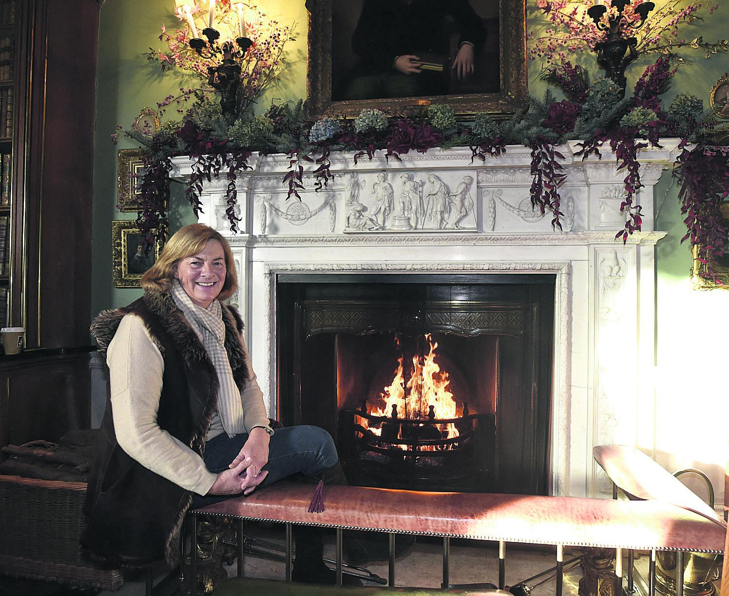 Lady Lansdowne next to the Christmas fireplace at Bowood House, which is hosting a festive fair