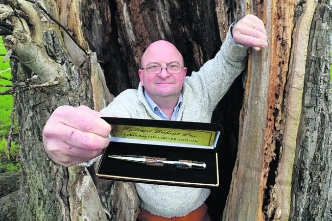 Local craftsman Simon Webb has created a limited edition heavyweight pen from wood salvaged from a 300-year-old walnut tree which fell down in last year's winter storms at Lydiard Park. Picture: STUART HARRISON