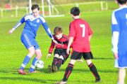 Ferndale's Ryan Jones goes in on Swindon Supermarine Harry Truman