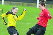 Highworth Town Ladies' Sarah Rayworth goes in for a tackle