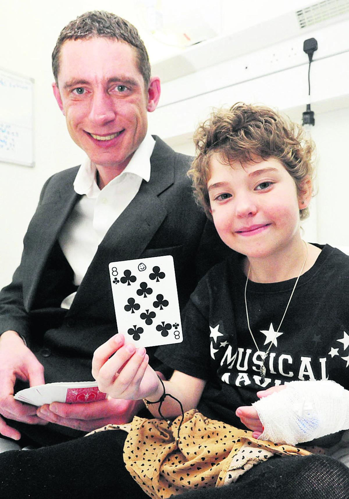 Magician Andy Cole had the magic formula for entertaining youngsters at Great Western Hospital, including Maddie Shurmer,