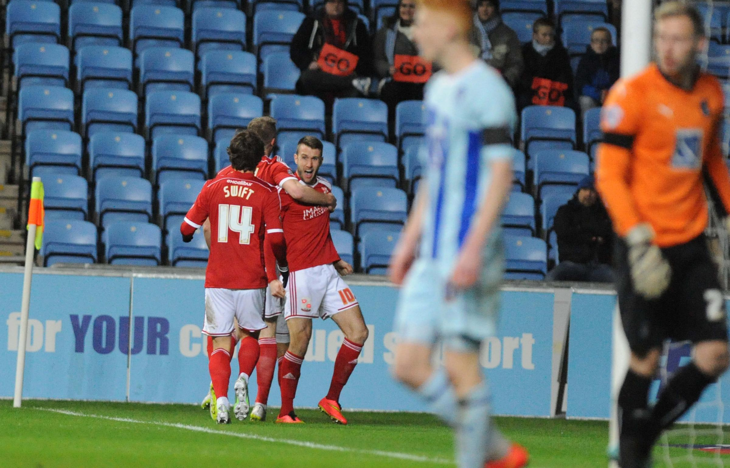 Andy Williams takes the congratulations of Swindon Town team-mates Michael Smith and John Swift after putting his side a goal up at Coventry City (Picture: Dave Evans)