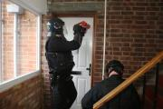 Police enter a Swindon home today as part of Operation Harness. Picture by Stuart Harrison