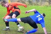 Stratton Juniors Max Wills and Old Town United's Troy Lonsdale battle during their Under 13 Division Three match on Sunday