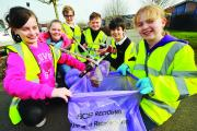 Zara, Rhiana, Archie, Riley, Cameron and Hannah carry out a sponsored litter pick. Picture: DAVE COX