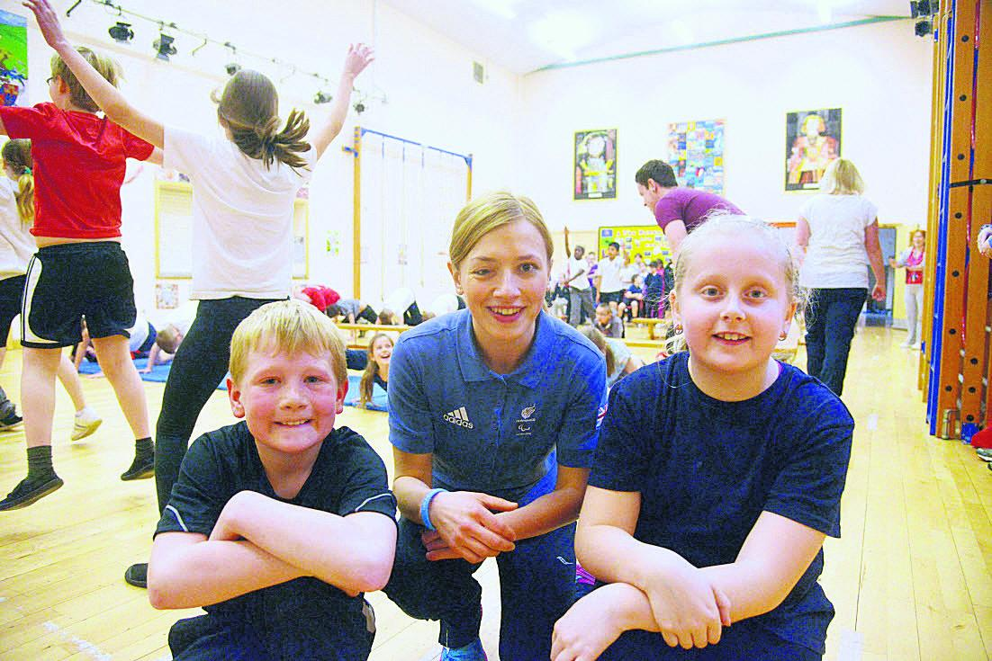 Paralympic sprinter Katrina Hart with Shaw Ridge Primary School sports ambassadors